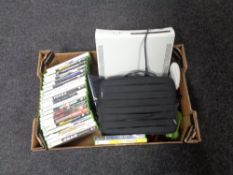 A box containing X-Box 360 console with leads, controller, accessories and games.