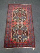 A Baluchi rug 131 cm x 70 cm