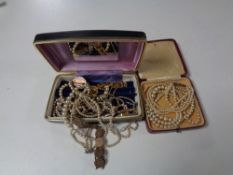 Two boxes containing assorted costume jewellery to include coin bracelets, pearl necklaces,