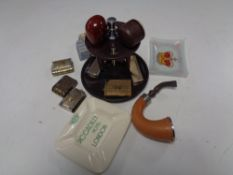A tray containing smoking items to include pipe stand and pipes (one with silver collar),