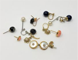 A cuff link marked 9ct, together with other costume jewellery,