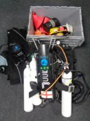 A large quantity of diving equipment to include tanks, regulators, diver's knife, weights,
