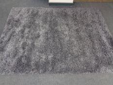 A contemporary grey shaggy pile rug.