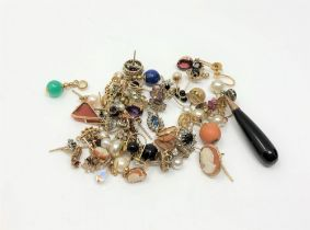 Sixty gold mounted earrings and pendants variously set with sapphire, diamond, ruby, opal, emerald,