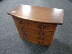 A miniature Victorian style apprentice piece five drawer chest, height 31 cm, width 36 cm.