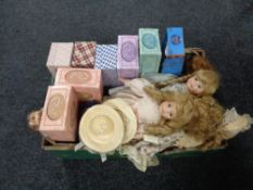 A box containing boxed and unboxed porcelain headed dolls.
