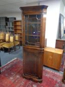 A reproduction Georgian style corner display cabinet, fitted cupboard beneath.