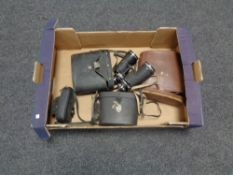 A box of four sets of assorted binoculars (three cased),