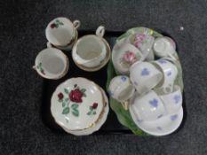 A tray of decorative glass scalloped edge dishes, tea china,