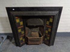 A Victorian cast iron tiled fire insert