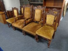 A late 19th century carved oak lady's and gent's armchair upholstered in a gold brocade fabric