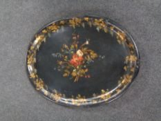 A Victorian papier mache tray with hand painted floral and grape leaf decoration (losses)