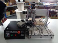 A CNC 4030Z desktop CNC engraving machine with control unit and accessories.