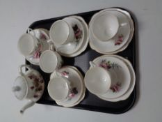 A tray containing six Duchess bone china trios together with an antique china teapot.