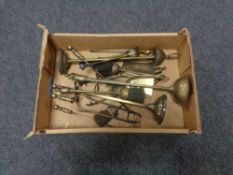 A box of brass companion stands and pieces