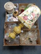 A palate containing five boxes of assorted glassware and china together with a glazed pottery table
