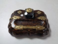 A late nineteenth century walnut desk stand with brass mounts and glass inkwells