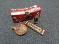 A Chinese style table box containing tourist items