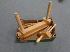 A box containing wooden vices.