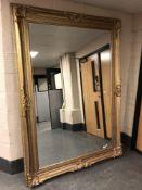 An impressive gilt framed leaning 7' x 5' mirror.
