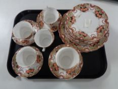 A tray containing 31 pieces of antique English floral patterned tea china.