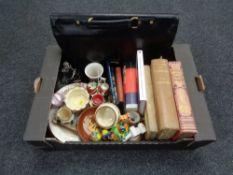 A box of assorted books, Harry Potter, Devon ware, cruet set, material, walking sticks,