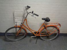 A lady's Velolux shopper bike (rear wheel locked)