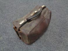 A vintage leather doctors bag