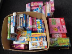 Three boxes of assorted board games,