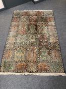 A Ghom silk rug of compartmentalised design,