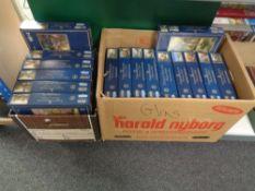 Two boxes containing 16 Gibson's Thomas Kinkade jigsaws.