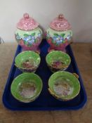 A pair of Maling lidded vases together with a set of four Rosine dishes (a/f)