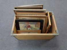 A crate containing continental school pictures and prints, black and white etchings,