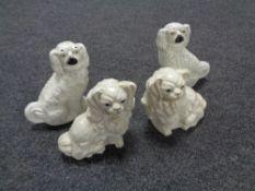 Two pairs of early twentieth century dog figures