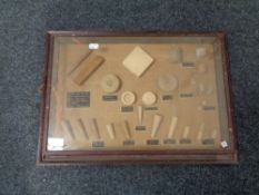 A display frame containing wooden plugs and bungs