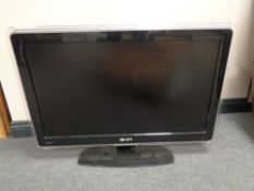 A Samsung 32'' LCD TV together with a Phillips 37'' LCD TV with remotes and continental wiring.