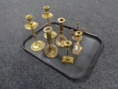 A tray containing three pairs of twentieth century brass candlesticks together with a three way