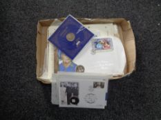 A box of Royal Family first day covers,