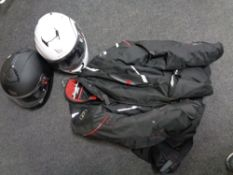 Two MT motorcycle helmets together with a motorcycle jacket.