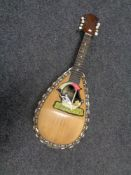 A bowl back mother of pearl inlaid mandolin