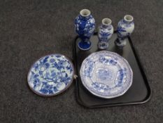 A tray containing three Chinese blue and white vases together with two antique blue and white