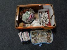 A box of antique doll, china and metal thimbles, racks,