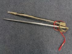 An Indian brass handled sword in scabbard