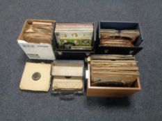 Four cases and a box containing vinyl 78's.