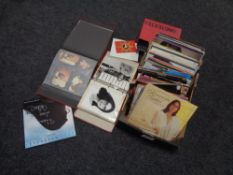 Two boxes containing Nana Mouskouri LPs, some signed,