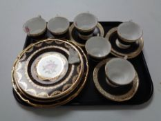 A tray containing six Royal Stafford pink rose patterned teacups and saucers together with similar