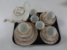 A tray containing 19 pieces of white and gilt tea china together with a further Victorian china