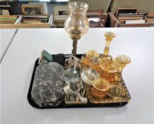 A tray of brass candle holder with glass shade, cased Art Deco manicure set,