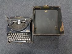 A vintage Remington home portable typewriter in case
