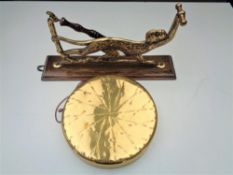 An early twentieth century dinner gong and beater on wall bracket modelled as a monkey